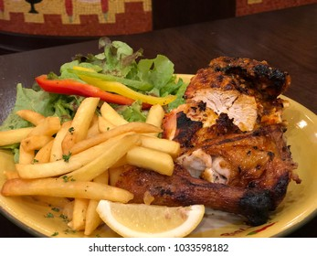 Grilled chicken with fries and salad