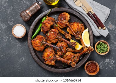 Grilled chicken legs with spices. Turkish Pirzola Kebab .