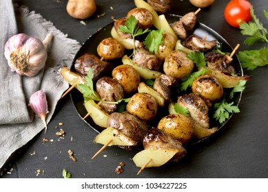 Grilled chicken liver, potato and bell pepper skewers. Dish for dinner.