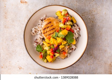 Grilled chicken with mango avocado salsa and rice, top view