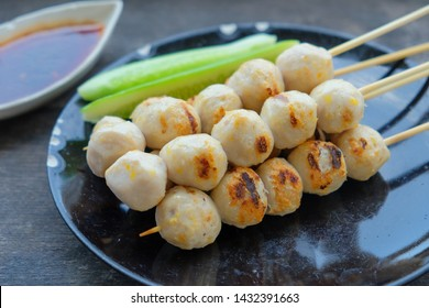 Grilled chicken meat ball on dish with sauce drip