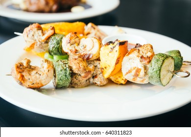 Grilled Chicken meat bbq with sauce in white plate