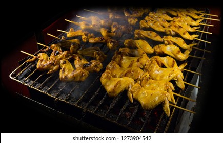 Grilled chicken at night market street food festival of Thailand.