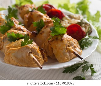 Grilled chicken on bamboo skewers, close up view