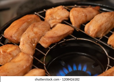 Grilled chicken on gas grill, selective focus