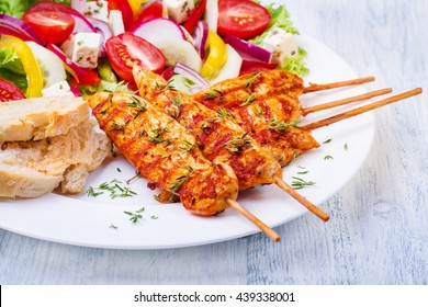 Grilled chicken on a stick with vegetables