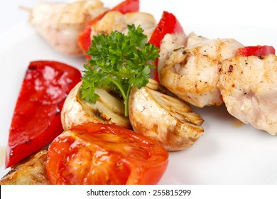 Grilled chicken and pepper on skewers