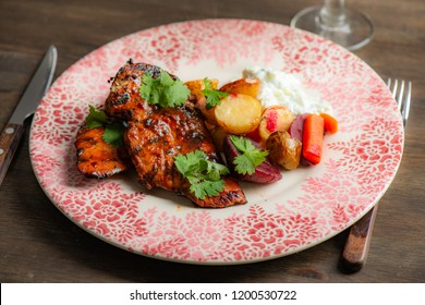 Grilled chicken with potatoes and salad