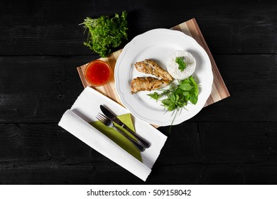 Grilled chicken with rice and herbs - Shutterstock ID 509158042