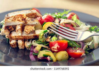 Grilled chicken salad and vegetables. Dietetic healthy food.