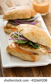 Grilled chicken sandwich with roasted red pepper sauce