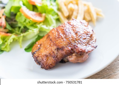 grilled chicken steak with french fries and vegetable salad on plate