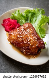 grilled chicken steak with teriyaki sauce and sesame