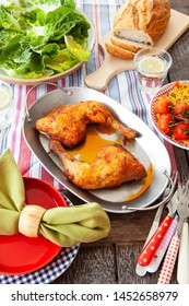 Grilled chicken thighs with fresh colorful salads
