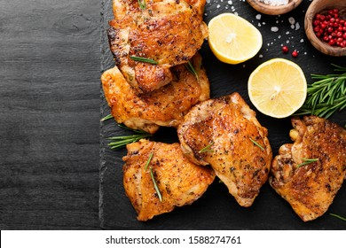 Grilled chicken thighs with spices and lemon. Top view