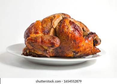 Grilled chicken, is a traditional Peruvian food, served with potatoes and salad, PERUVIAN FOOD