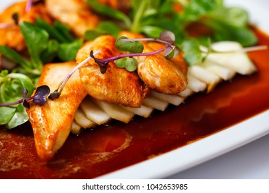 Grilled chicken with vegetable and herbs on sauce plate