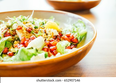Grilled chicken with vegetable and pomegranate , fruits salad in
