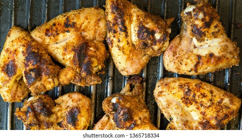 Grilled Chicken Wings Bar Food golden brown seasoned ready to be served for lunch or dinner meal or as snack at home or tailgating or informal gathering like barbecues.