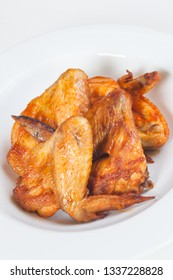 Grilled Chicken Wings in a white bowl