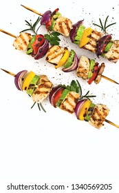 Grilled chiken shish or kebab on skewers with vegetables . Food on white background shashlik