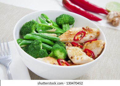 Grilled chilli chicken with steamed broccoli, snow peas, green beans and ginger