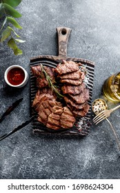 Grilled chopped steak with rosemary and whiskey on stone background