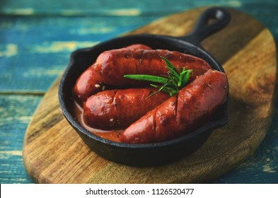 Grilled chorizo on frying pan