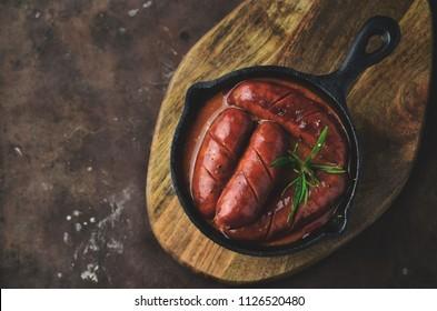 Grilled chorizo on frying pan