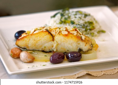 Grilled cod with garlic and olives and broccoli rice.