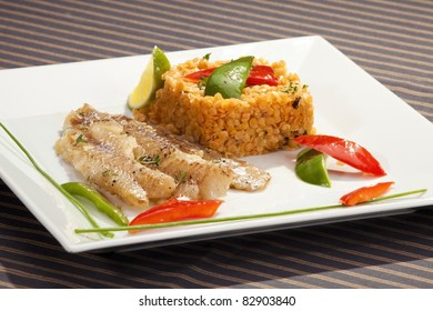 Grilled codfish with red lentil and bell pepper slices