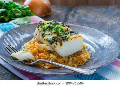 Grilled coriander and lemon cod with carrot pilaf