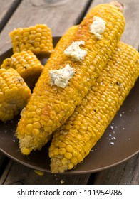 Grilled corn with butter, selective focus