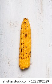Grilled corn cobs on the old vintage table. Tipical american food
