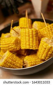 Grilled corn on a stick. head of corn on a stick. Grilled sweet corn on the cob.