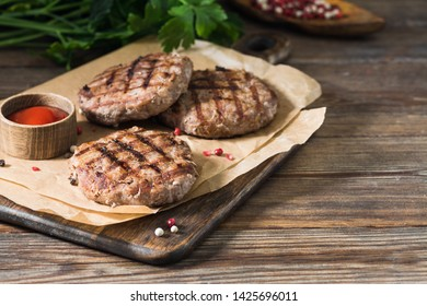 Grilled cutlets on a wooden Board on a wooden table. Rustic style