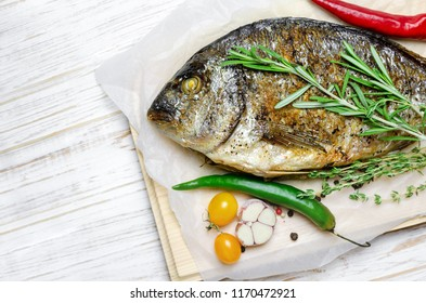 Grilled Dorado with herbs and red pepper
