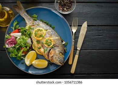 Grilled Dorado with lemon, thyme, rosemary and fresh salad