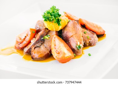 Grilled duck breast meat with sweet sauce in white plate