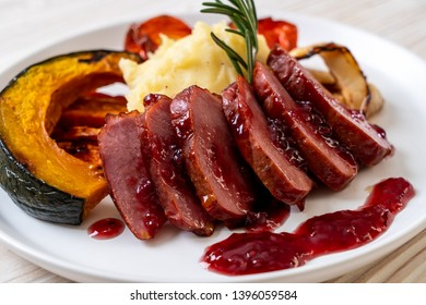 grilled duck breast with sauce, mash potatoes and vegetable