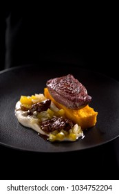 grilled duck breast steak served with liver and pineapple salsa