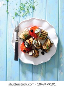 Grilled eggplant rolls with feta and herbs.