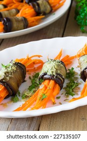 Grilled eggplant rolls with spicy carrot, pumpkin seeds and fresh herbs