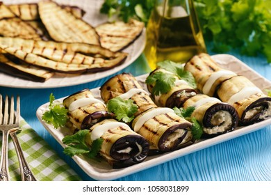 Grilled eggplants rolls with cream cheese, garlic and herbs.
