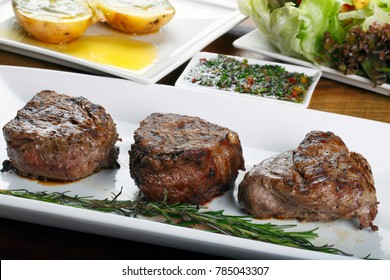 grilled filet mignon with potato and salad