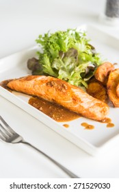 Grilled Fillet Salmon steak in white dish
