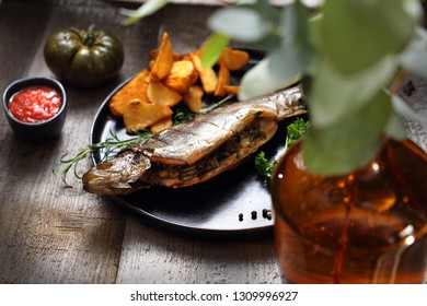 Grilled fish. Brown trout baked with herbs.
