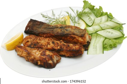 Grilled Fish Fillet with on barbecue with vegetables