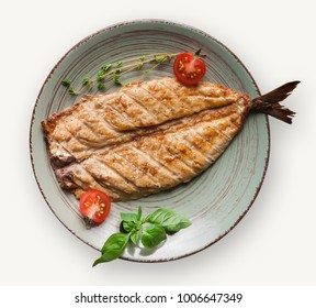 Grilled fish fillet on plate isolated on white background. Cutout and mockup for restaurant menu, top view