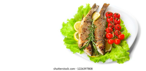 Grilled fish, fried perch fish with vegetables isolated on white background. Sea food. Diet, Dieting. healthy eating